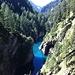 Le acque del lago di Luzzone si incuneano come un fiordo nella Valle di Garzora