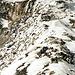 Die eis- und schneebedeckten Felsen führen von der Porta da Gliems auf den Gipfel des Stoc Grond.