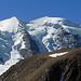 Der Gipfel des Piz Trovat mit Stein- und Fleischmännchen drauf vor dem östlichen Piz Palü. Gesehen vom Sass Queder.