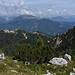 Monte Lussari, in fondo il panettone erboso del Monte Osternig (2052), a destra la Croce del Poverello.