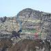 Übersicht Sass d'Argent Westwand<br />rot: Versuch einer neuen Linie<br />grün: Plattenquerung (I-II)<br />blau: etwa Route 53.1 Seite 227 [http://www.topoverlag.ch/klettern.php TICINO keepwild! climbs]