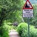 Warnschild am Beginn des Weges durch die Nevis-Gorge. Naja, sooo ausgesetzt war's dann doch nicht.