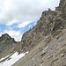 Am Fusse der Südwand des Piz d' Alp Val, links P.3041.<br />Meine Aufstiegroute setzt beim winzigen Scheefleck an, von dort auf einem breiten Band nach links sanft ansteigend.