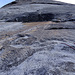 The famous first pitch of Snake Dike: you climb the slabs to the left to avoid the roof and reach a...