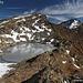 Laghetto Grande della Miniera già ghiacciato, sullo sfondo la cima del Schenadüi.
