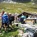 Festa all'Alpe Piodella, notare lo bottiglie di distillati sul tavolo