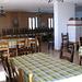 interno della sala pranzo del rifugio Croce di Campo: quella enorme stufa è a legna e riscalda benissimo tutta la sala