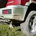 Ungewöhnliche Reparatur : ein bisschen Draht und schon ist Stossdämpfer hochgebunden :-)