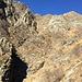 Il canale del Funtanasc. L'alpeggio è alla base dello sperone roccioso al centro della foto
