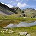 Wyssgrat und Ochsehorn spiegeln sich im Moos von Obers Fulmoos.