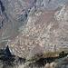 laggiu', nascosta tra gli alberi, c'è la cascina di Terasc.  si distingue bene il Riale della Stadera. vista da Oglié