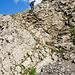 Eine Wandrerin von einer anderen Gruppe beim Abstieg in der letzten anspruchsvolleren Kraxelpassage