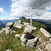 View on Pianca Bella: On the left the Leventina-, on the right Blenio valley, the peak behind the cross is Pizzo Erra