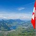Gipfelflagge vor sehenswertem Hintergrund