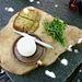 Frischer Geissenkäse mit selbstgebackenem Brot und Ruccola aus dem eigenen Garten.