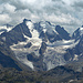 Zoom, über der Berninagruppe kommen Wolken auf.