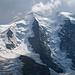 Ein erster Blick zum Piz Palü - Noch im Wechsel aus Sonne und Wolken