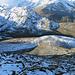 Schon bald geht es in den steilen Gipfelhang und der Blick weitet sich hinüber zu den hohen Bergriesen des Bernina Massivs.