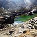 i miseri resti del laghetto carino fra le rocce dopo la vecchia capanna Cristallina