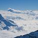 Ein bunter Mix von Wolken auf verschiedenen Höhenstufen. Die Hochnebelgrenze steigt allmählich an.