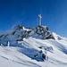 Gipfelkreuz Dreizehntenhorn. Wieder lässt der Wind am Himmel (Schnee-)Sterne scheinen.