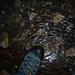[U Delta]s Fuss auf Höhlengletscher-Eis