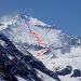 Hausstock NE-Wand mit unserer Route. Rot: mit Ski, blau: zu Fuss.