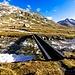 Ponte d'attraversamento sul Rein da Sumvitg, a sinistra in alto al Cima P. 3066 m, punto dove dobbiamo arrivare