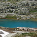 The small unnamed turquoise lake at elevation 2495 m.