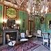 """Salòotto di Palazzo La Marmora. Le boiserie verdi sono arricchite da altorilievi in finto avorio, in realtà una """"pastella di riso""""."""
