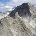 la vetta del Torrione di Zocca spicca sull'ombroso versante occidentale del Monte di Zocca.