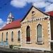 Vom Wirbelsturm Danny 2015 gezeichnete Roman Catholic Church in Saint John's. Die Kirche wird gerade restauriert aber die Baustelle macht den Eindruck, dass das Geld fehlt.