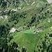 Alp de Calvaresc Desora, con la cascata formata dall' emissario del lago