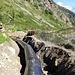 Enfouissement de la nouvelle canalisation amenant l'eau du lac de Fah.