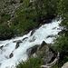 das Tal führt eine Stufe hinab, und so wird auch der Fluss wilder