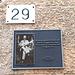 """<b>In Via 20 settembre, al numero civico 29, una targhetta ricorda la figura dell'autore di quello che è stato descritto come il più grande furto d'arte del 20° secolo.<br />La targa è stata voluta da Joe Medeiros, regista del film """"The Missing Piece"""". </b>"""