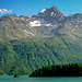 Canale Nord, Piz da la Margna. In 2004 (Fotodatum) war nicht mehr viel von dem Murtairac Gletscher übrig, heute vermutlich noch weniger. Das Nord Couloir ist gut zu erkennen. Der Normalweg folgt der ansteigenden Linie über dem See, auf die Rückseite des Berges, und gewinnt den NO Grat am Punkt 2980