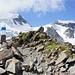 Langsam werden die Gipfel hinter der Hütte sichtbar