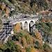 Belgischer EC (mit 2 Schweizer Bpm51 ergänzt) auf dem Lüegilchi-Viadukt bei Hohtenn, mittels Teleoptik von Pt. 1147.9 aus gesehen.