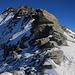 Der Abstieg vom Gipfel zurück zu meinem Schneeschuhdepot beim Gratvereinigungspunkt P.3024m war problemlos, auch dank meiner gelegten Aufstiegsspur :-)<br /><br />Am Gratende ist auch der Gipfel vom Auf dem Piz Timun / Pizzo d'Emet (3212m) zu sehen.