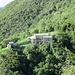 Dal sentiero n° 7, bella vista sull'Abbazia di San Pietro al Monte, complesso architettonico in stile romanico situato nella Valle dell'Oro nel Comune di Civate.