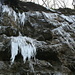 Icicles hanging from the rocks