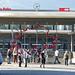 Überall hin mit der Bahn! - Das Tor zur Schweiz!  Zitat: Über der Rolltreppe, die den Bahnhofsplatz mit der Bahnhofsunterführung verbindet, hängen zwei grosse Umirsse aus Plexiglas. Beim Gerüst der Grenzen werden die Grenzlinien der Schweiz (in rot) und des Kantons Graubünden (in blau) übereinander gelegt. Durch die Überlagerung des Grenzverlaufs erschliesst sich eine spezielle Grenzraumwelt. Das Spiel mit den ähnlichen Grenzlinien betont deren Zufälligkeit auf dem historischen Hintergrund und der heute eher inselhaften Realität.   Das Kunstwerk am Bau ist von Christoph Rütimann. Wer nach Chur und Graubünden kommt, lässt die Schweiz hinter sich und wer Chur verlässt, reist in die Schweiz – so die Idee des Künstlers.