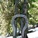 Targa a forma di ferro di cavallo, dà il benvenuto in Pian d'Alpe