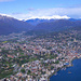 Tiefblick auf Lugano, die frisch verschneiten Gipfel und die Ausläufer des schlechten Wetters im Norden