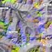 Falschfarben-Satellitenbild des Val Chamuera. Hellgrün (Piz Mezzaun): Dolomit, Grün (Lavirun): Granit, Rötlich (Munt Cotschen): Stark oxidierte Gneisse usw