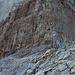 """2003: Einstieg in den Klettersteig, gleich zu Beginn die """"Schlüsselstelle"""", viele Leiter führen durch eine steile Wand"""