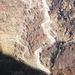 Veduta profonda sulla Capanna Osola, con i segni dell'autunno in Val d'Osura