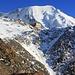 Noch wenige Meter trennen uns vom Tagesziel Refuge de Tête Rousse (3167m) die vor der Nordwand der Aiguille de Bionnassay (4052m) steht.