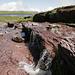 Roter Verrucano, im Hintergrund das Madseeli